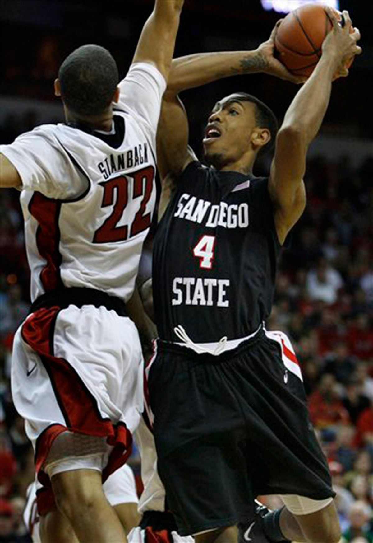 San Diego State's Malcolm Thomas tries to shoot over UNLV's Chace Stanback during an NCAA college basketball game at the Mountain West tournament finals in Las Vegas on Saturday, March 13, 2010. San Diego State defeated UNLV for the championship title. (AP Photo/Laura Rauch) (Laura Rauch)