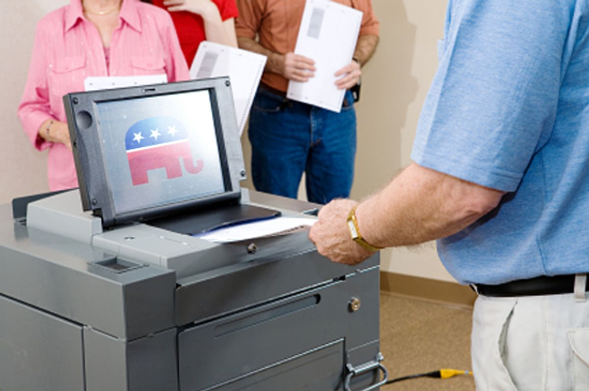 Closeup of senior man voting on an optical scanner with people waiting in line. (Lisa F. Young)