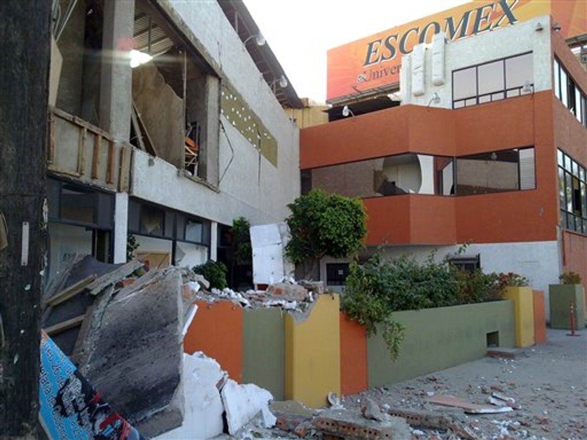 """This photo provided by Jorge Rivera aka """"cimarron98"""" via Twitter shows structural damage to the Escomex business school building after an earthquake in Mexicali, Mexico, Sunday, April 4, 2010. The 7.2-magnitude quake struck at 3:40 p.m. in Baja California, Mexico, about 19 miles southeast of Mexicali, according to the U.S. Geological Survey. (AP Photo/Jorge Rivera) NO SALES. (AP)"""