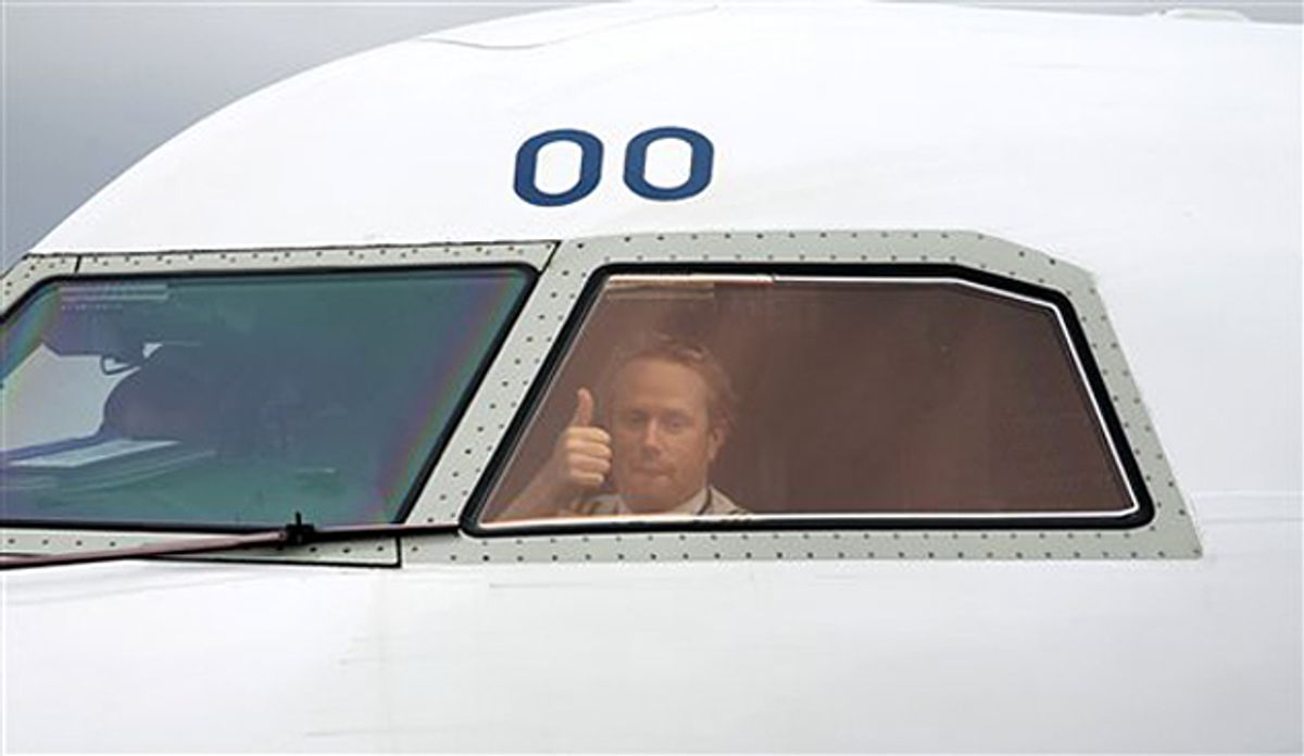 A pilot gives the thumps up to as gets the go ahead to leave Belfast City Airport, Northern Ireland, Tuesday, April, 20, 2010.  Europe began allowing limited air traffic to resume, giving hope to millions of travelers stranded around the world when ash from a volcano in Iceland choked the jet age to a halt.  (AP Photo/Peter Morrison) (Peter Morrison)
