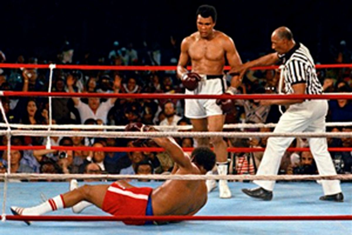 """FILE - In this Oct. 30, 1974 file photo, referee Zack Clayton, right, steps in after challenger Muhammad Ali looks on after knocking down defending heavyweight champion George Foreman in the eighth round of their championship bout in Kinshasa, Zaire. Ali regained the world heavyweight crown by knockout in the eighth round of the fight dubbed """"Rumble in the Jungle."""" (AP Photo/File) (Anonymous)"""