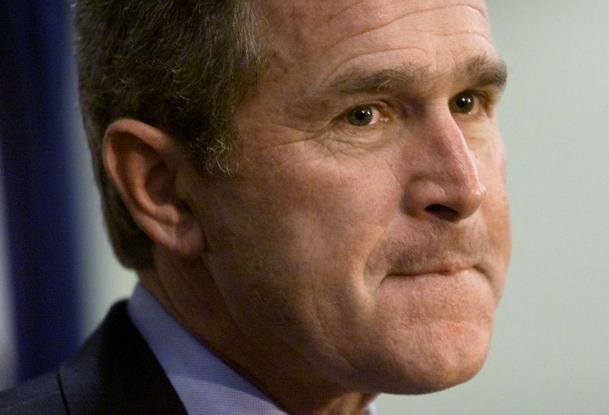"""Republican presidential candidate George W. Bush listens to a reporter's question about his position on abortion January 20. Bush said he thought the 1973 Roe v. Wade Supreme Court decision on abortion was a """"reach"""" and over stepped constitutional bounds.  RTW (Reuters)"""