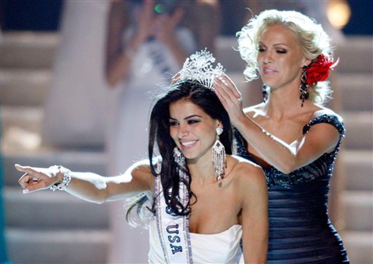 Miss Michigan Rima Fakih reacts as she is crowned Miss USA 2010 Sunday, May 16, 2010 in Las Vegas.  (AP Photo/Isaac Brekken) (AP)