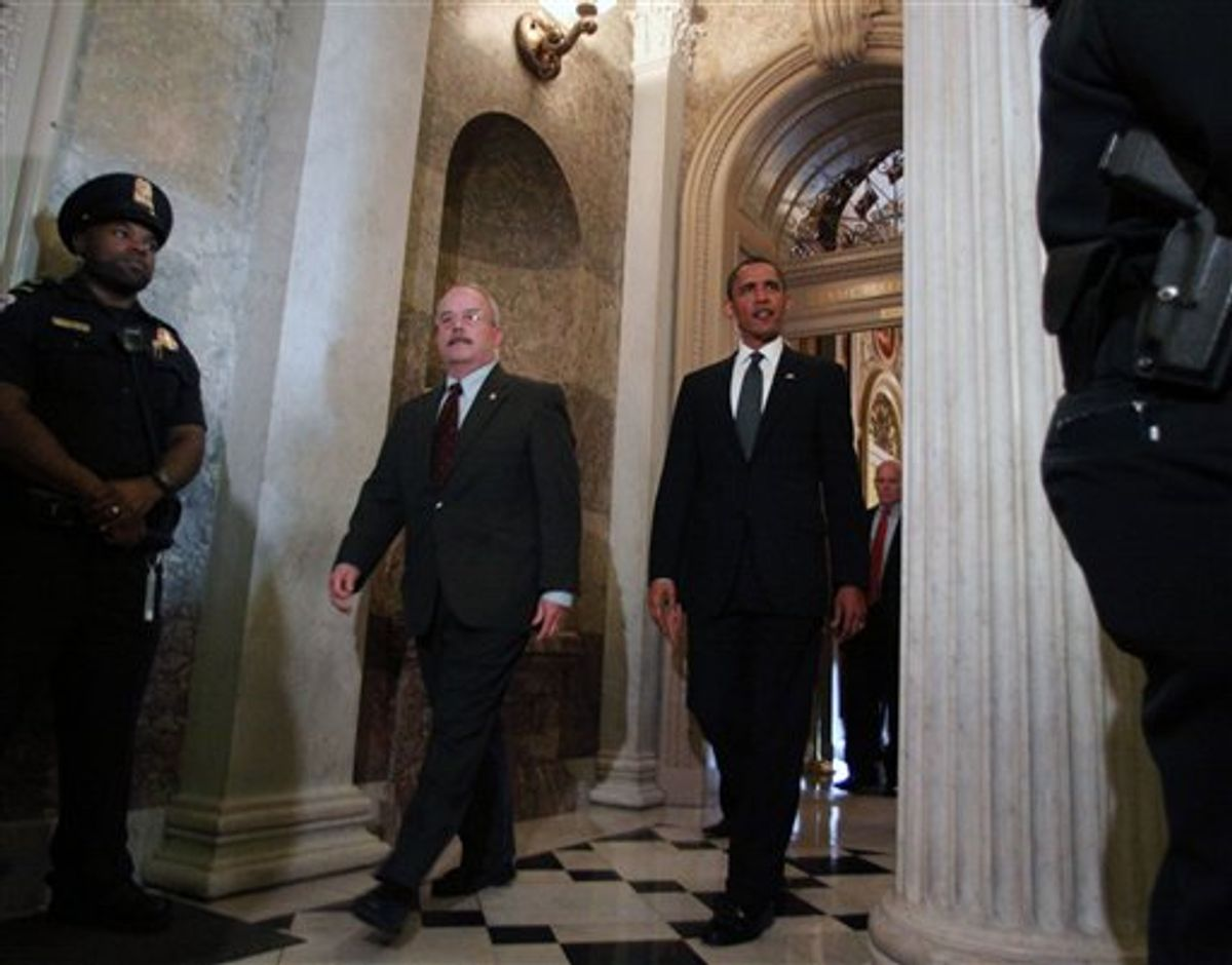 President Barack Obama, escorted by Senate Sergeant-at-Arms Terrance Gainer, leaves Capitol Hill in Washington, Tuesday, May 25, 2010, after a meeting with Senate Republicans behind closed doors for talks ranging from jobs to the massive Gulf oil spill and prospects for strengthening border security this election year. (AP Photo/Lauren Victoria Burke) (AP)