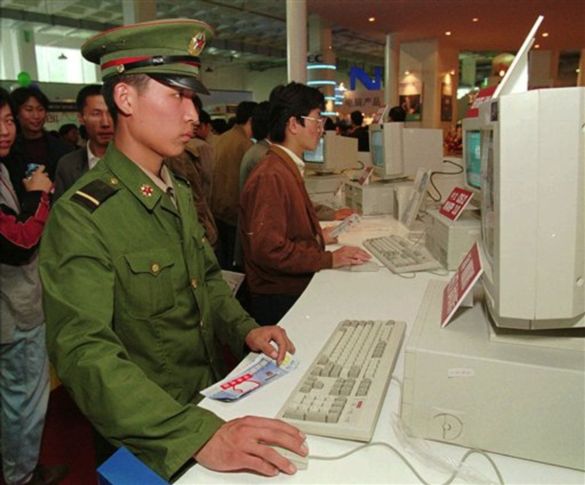 FILE - In this Oct. 10, 1995 file photo, a Chinese soldier tries out a desktop computer at a computer exhibition in Beijing. Rigid restrictions on Internet usage imposed this month on the 2.3-million strong Chinese armed services are sure to cramp the already lackluster social lives of the predominantly young, male force. Online dating was given the boot, along with blogs, personal websites and visits to Internet cafes. (AP Photo/Mike Fiala, File) (AP)