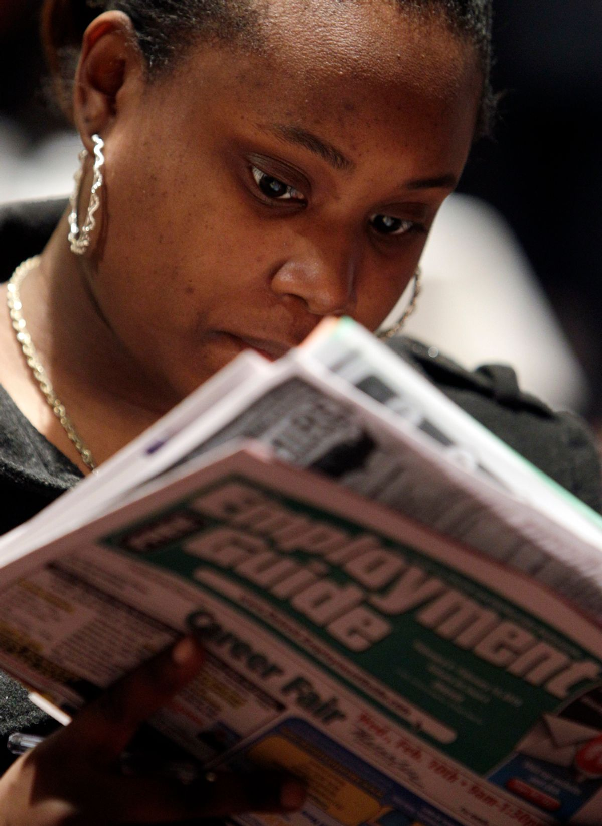 Santilya Bailey, of Detroit, looks for employment while attending a job fair in Detroit Wednesday, Feb. 10, 2010. The number of newly laid-off workers seeking unemployment benefits fell sharply last week, a hopeful sign the job market may be improving.(AP Photo/Paul Sancya)   (Paul Sancya)