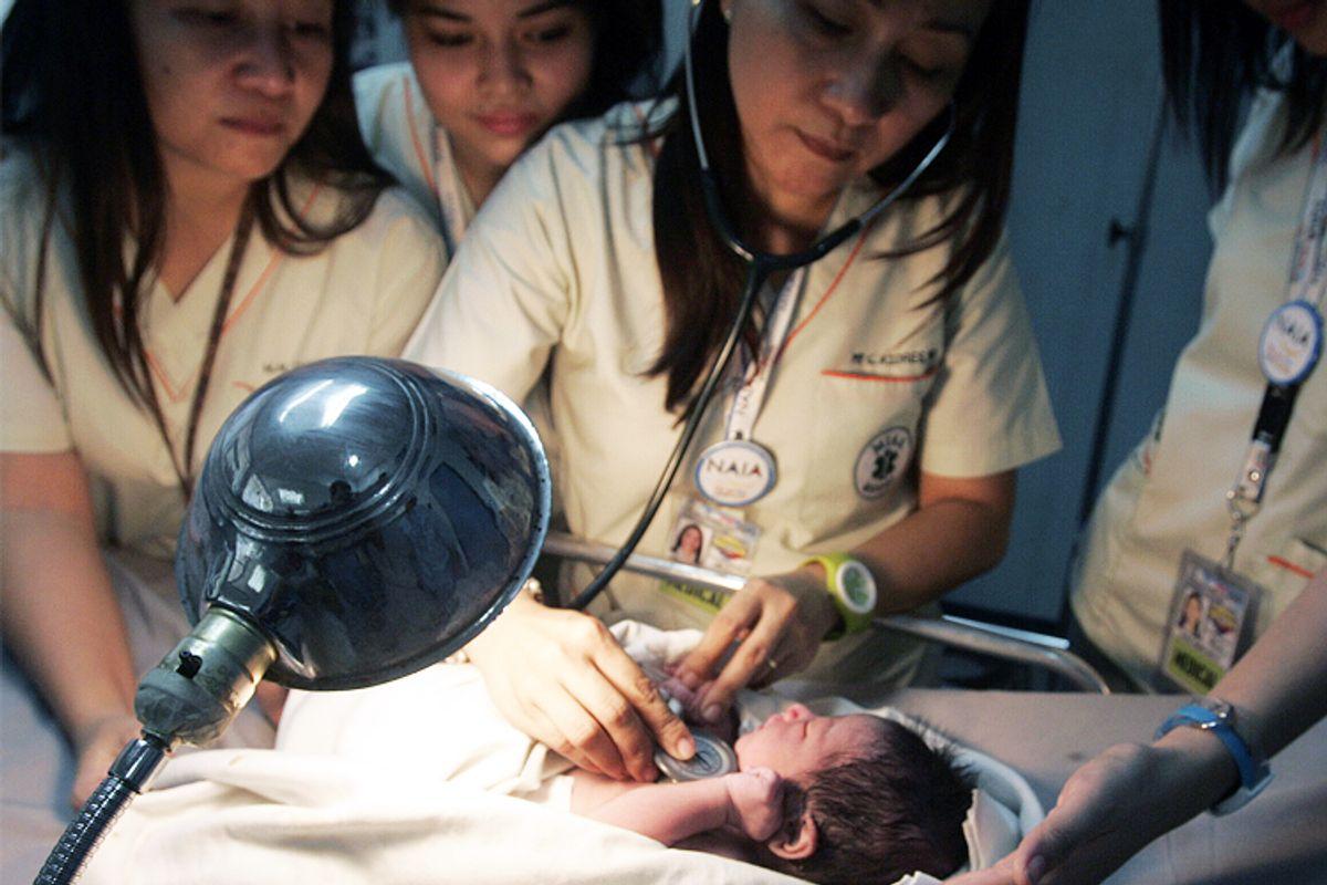 Nurses check the heartbeat of a newborn baby found inside the lavatory of an airplane at Manila's Ninoy Aquino International Airport.