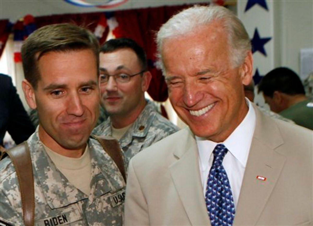 In this July 4, 2009 photo, U.S. Vice President Joe Biden, right, is seen with his son, U.S. Army Capt. Beau Biden, at Camp Victory on the outskirts of Baghdad, Iraq. Vice President Joe Biden's son was being treated at a Delaware hospital, the White House said Tuesday, though it did not provide information about what might be wrong. Delaware Attorney General Beau Biden was awake and alert and communicating with his parents and wife, who were with him at Christiana Hospital in Newark. (AP Photo/Khalid Mohammed)   (AP)