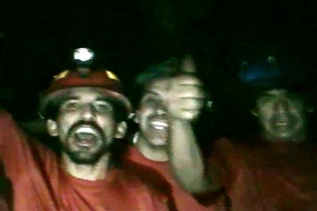 In this TV grab taken from a video released by Chile's government on Tuesday, Aug. 31, miners react inside the San Jose mine in Copiapo, Chile. Thirty-three miners have been trapped deep underground in the copper and gold mine since it collapsed on Aug. 5.  (AP Photo/Chile's Government Video) (AP)