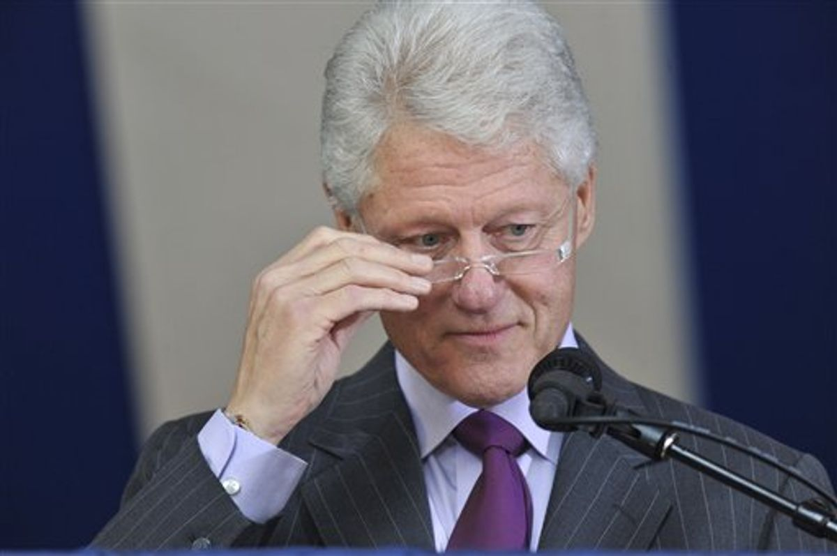 Former President Bill Clinton adjusts his glasses as he delivers the Yale Class Day Address at Yale University in New Haven, Conn., Sunday, May 23, 2010.  (AP Photo/Jessica Hill)  (AP)