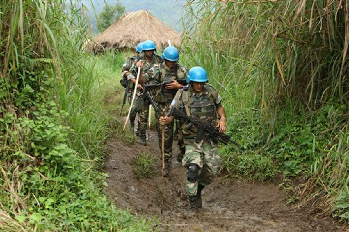 United Nations peacekeepers patrol near their encampment in the village of Kimua, deep in the heart of territory controlled by Rwandan Hutu rebels, in eastern Congo.   (AP/Rebecca Blackwell)