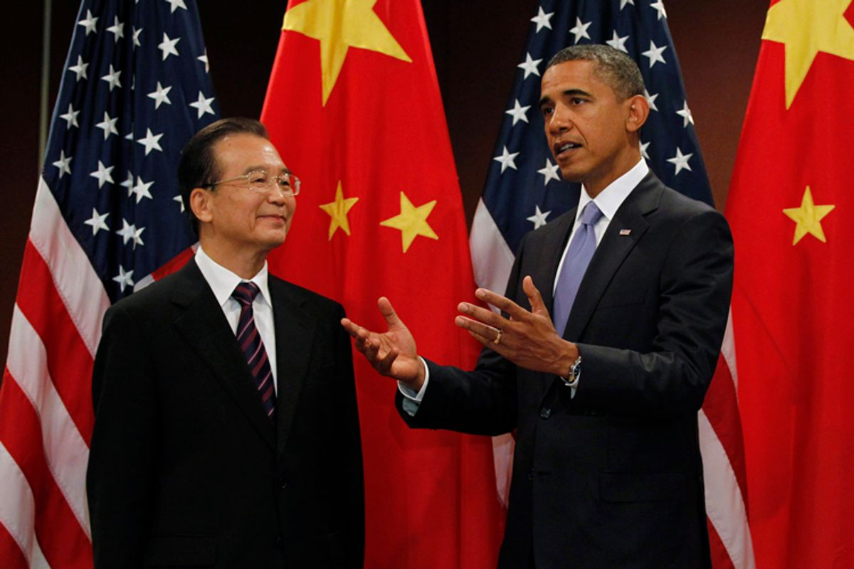 U.S. President Barack Obama gestures alongside China's Premier Wen Jiabao before their bilateral meeting at the United Nations in New York, September 23, 2010.    REUTERS/Jason Reed  (UNITED STATES - Tags: POLITICS)   (© Jason Reed / Reuters)