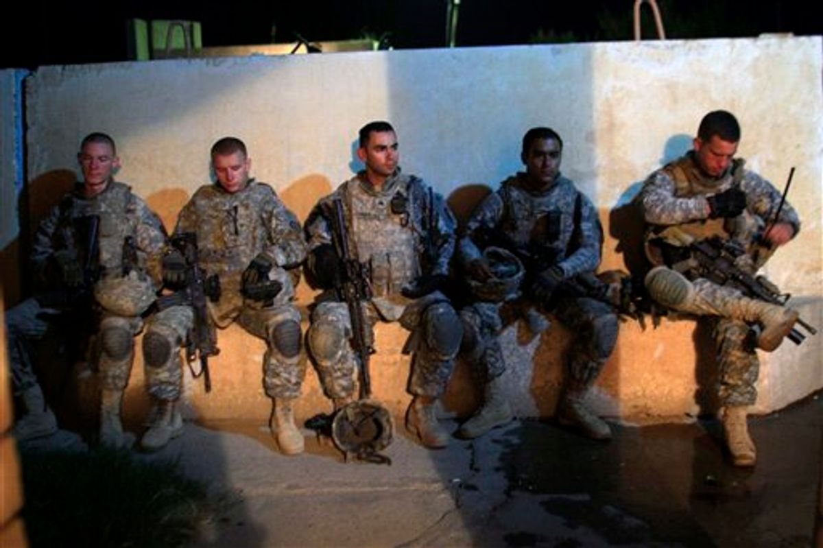 US Army soldiers from 1st Battalion, 14th Infantry Regiment sit in a courtyard outside an Iraqi police station during a joint operation with Iraqi security forces on the first day after America ended its combat role, Wednesday, Sept. 1, 2010 in Hawija, north of Baghdad, Iraq.  The U.S. marks on Wednesday the transition to the final phase of the Iraq war, shifting the focus of the remaining 50,000 American troops from combat operations to preparing Iraqi security forces to protect the country on their own. (AP Photo/Maya Alleruzzo) (AP)