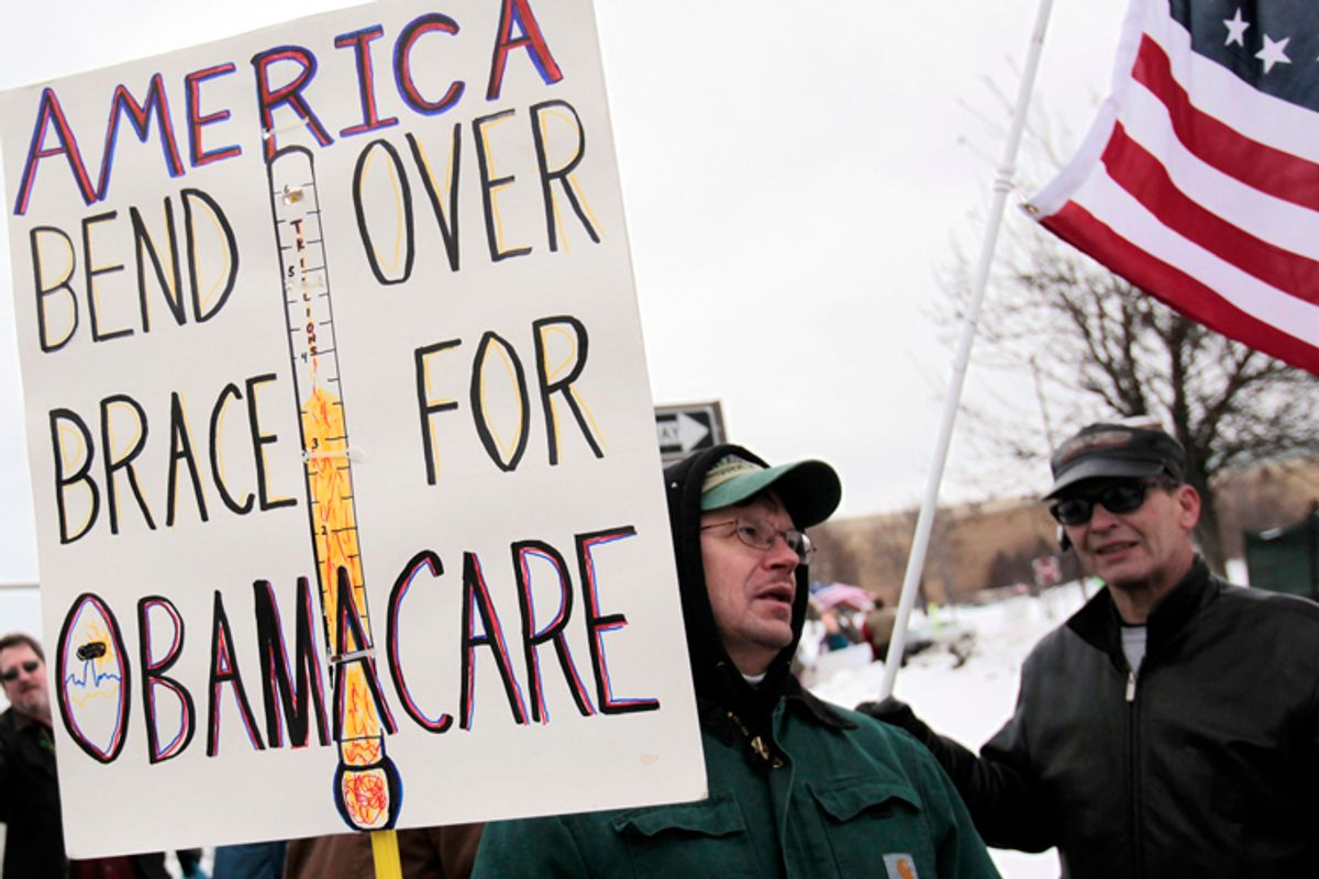 """A Tea Party member carries a sign voicing his concern over """"ObamaCare"""" during a rally marking the one-year anniversary of the movement in Troy, Michigan February 27, 2010. Some Tea Partiers say they can pinpoint the precise moment when they made it clear to the Republican Party they had no intention of being its lapdog. On a bright, brisk afternoon in mid-February, with snow still thick on the ground from storms that had battered Washington the week before, Republican National Committee Chairman Michael Steele met with more than 50 members of the Tea Party, the Twitter Age conservative movement that is reshaping the U.S. political landscape. Picture taken February 27, 2010. To match Special Report USA-POLITICS/TEAPARTY. REUTERS/Rebecca Cook  (UNITED STATES - Tags: POLITICS CIVIL UNREST)  (© Rebecca Cook / Reuters)"""