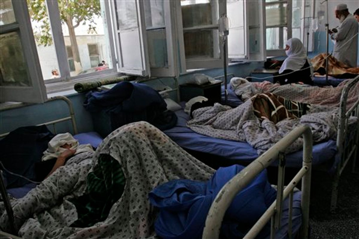 Afghan schoolgirls rest at a hospital in Ghazni, eastern Afghanistan, Saturday, June 12, 2010. More than three dozen school girls were hospitalized after becoming ill from suspected poisoning at their high school in Ghazni. There have been similar cases of illnesses at schools around Afghanistan. Some suspect militants are spraying schools with poison gas because they oppose education for girls. (AP Photo/Rahmatullah Naikzad) (AP)