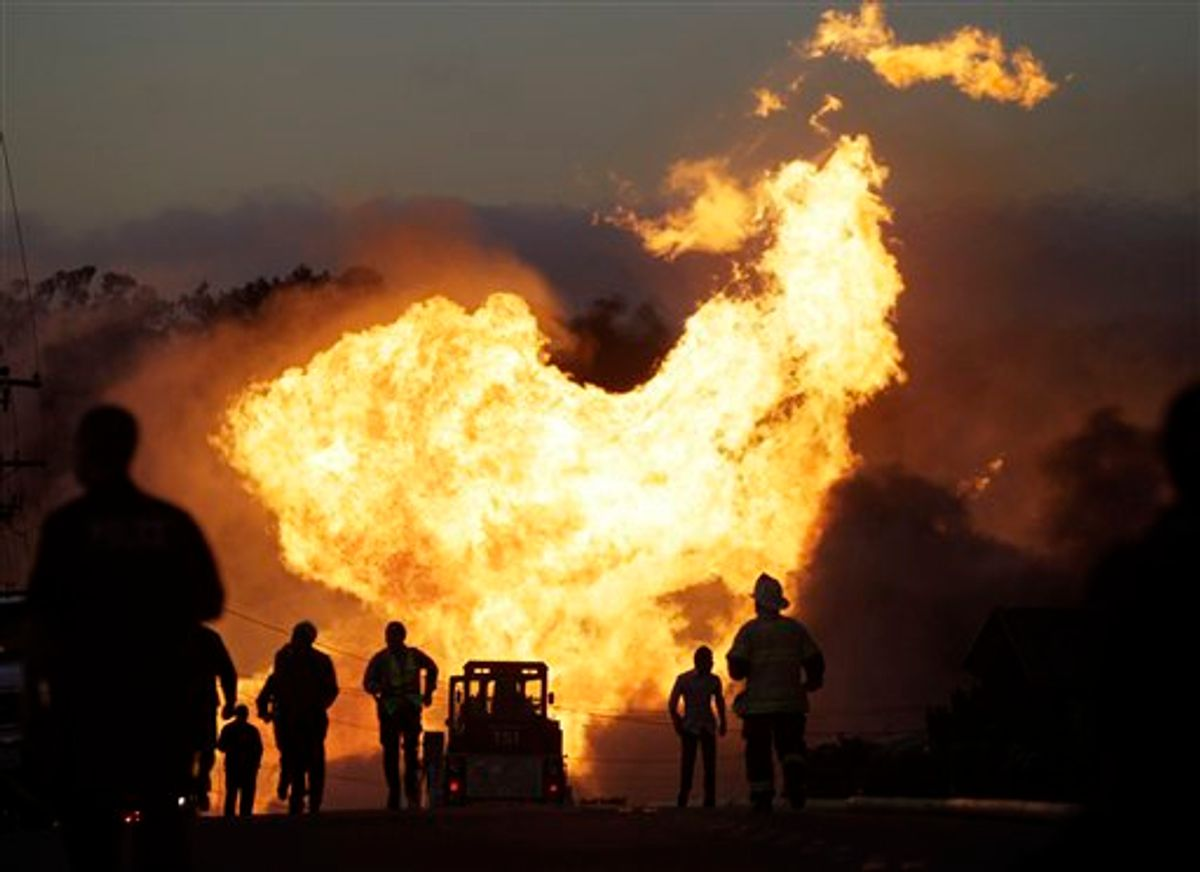 A massive fire is roars through a mostly residential neighborhood in San Bruno, Calif., Thursday, Sept. 9, 2010. Firefighters from San Bruno and surrounding cities are battling the blaze that started on a hillside and is now consuming homes in a residential neighborhood. (AP Photo/Paul Sakuma) (AP)