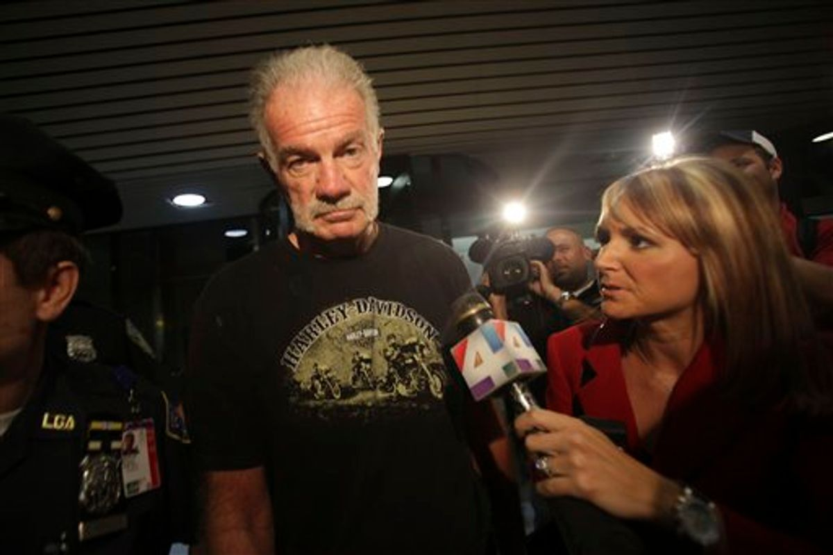 Pastor Terry Jones is surrounded by reporters as he arrives at Laguardia airport, Friday, Sept. 10, 2010 in New York.  (AP Photo/Mary Altaffer)  (AP)