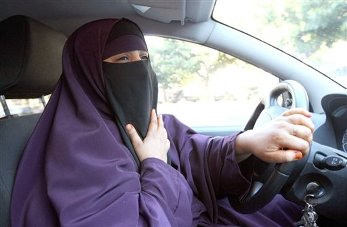 France's Kenza Drider , wearing a niqab,  drives a car  in Avignon, southern France, Monday, Sept. 13, 2010.   A ban on the burqa-style veil, to be voted on Tuesday in the Senate, would affect only a tiny minority of Muslim women _ estimated at less than 2,000 _ making it far less controversial than France's 2004 ban on Muslim headscarves in classrooms, which proliferated in heavily immigrant neighborhoods. (AP Photo/Claude Paris) (AP)