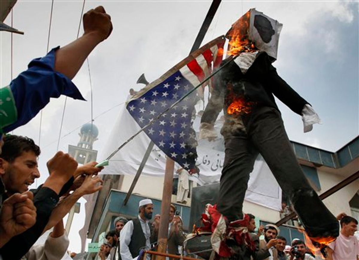 Afghans burn an effigy of Dove World Outreach Center's pastor Terry Jones during a demonstration against the United States in Kabul, Afghanistan, Monday, Sept. 6, 2010. Hundreds of Afghans railed against the U.S. and called for President Barack Obama's death at a rally in the capital Monday to denounce the American church's plans to burn the Islamic holy book on 9/11. (AP Photo/Musadeq Sadeq) (AP)