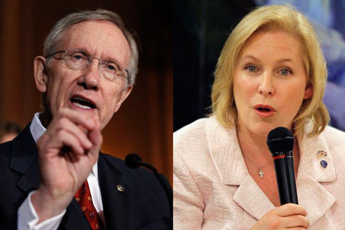 Sen. Harry Reid (D-Nev.) and Kirsten Gillibrand (D-N.Y.)