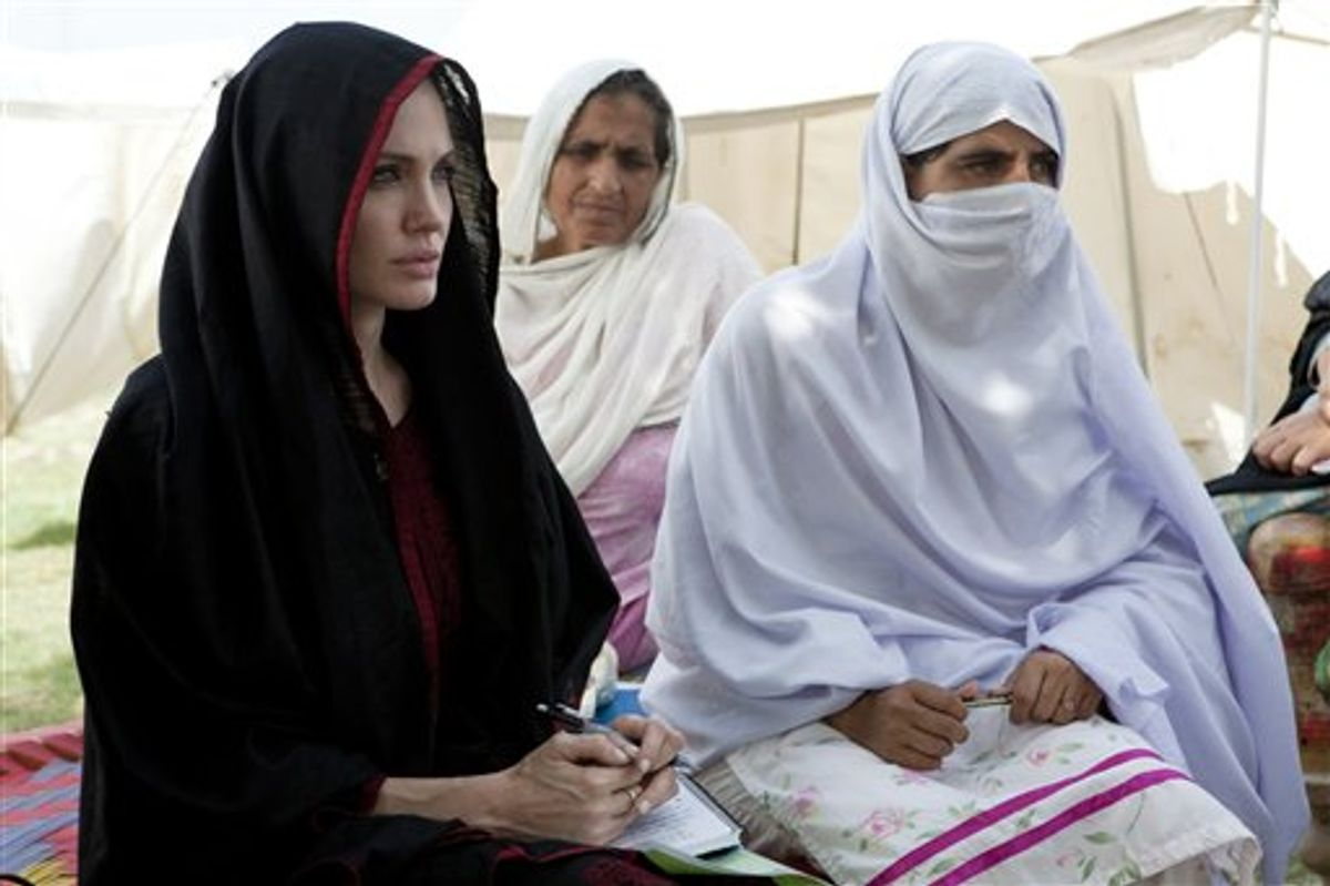 In this photo provided by the United Nations High Commission for Refugees, Angelina Jolie, left, the goodwill ambassador of UNHCR, sits with Pakistani flood-affected women during her visit to a camp for people displaced by heavy floods in Nowshera, Pakistan, Tuesday, Sept. 7, 2010. (AP Photo/United Nations High Commission for Refugees, J. Tanner) ** NO SALES, NO ARCHIVE, EDITORIAL USE ONLY **  (AP)