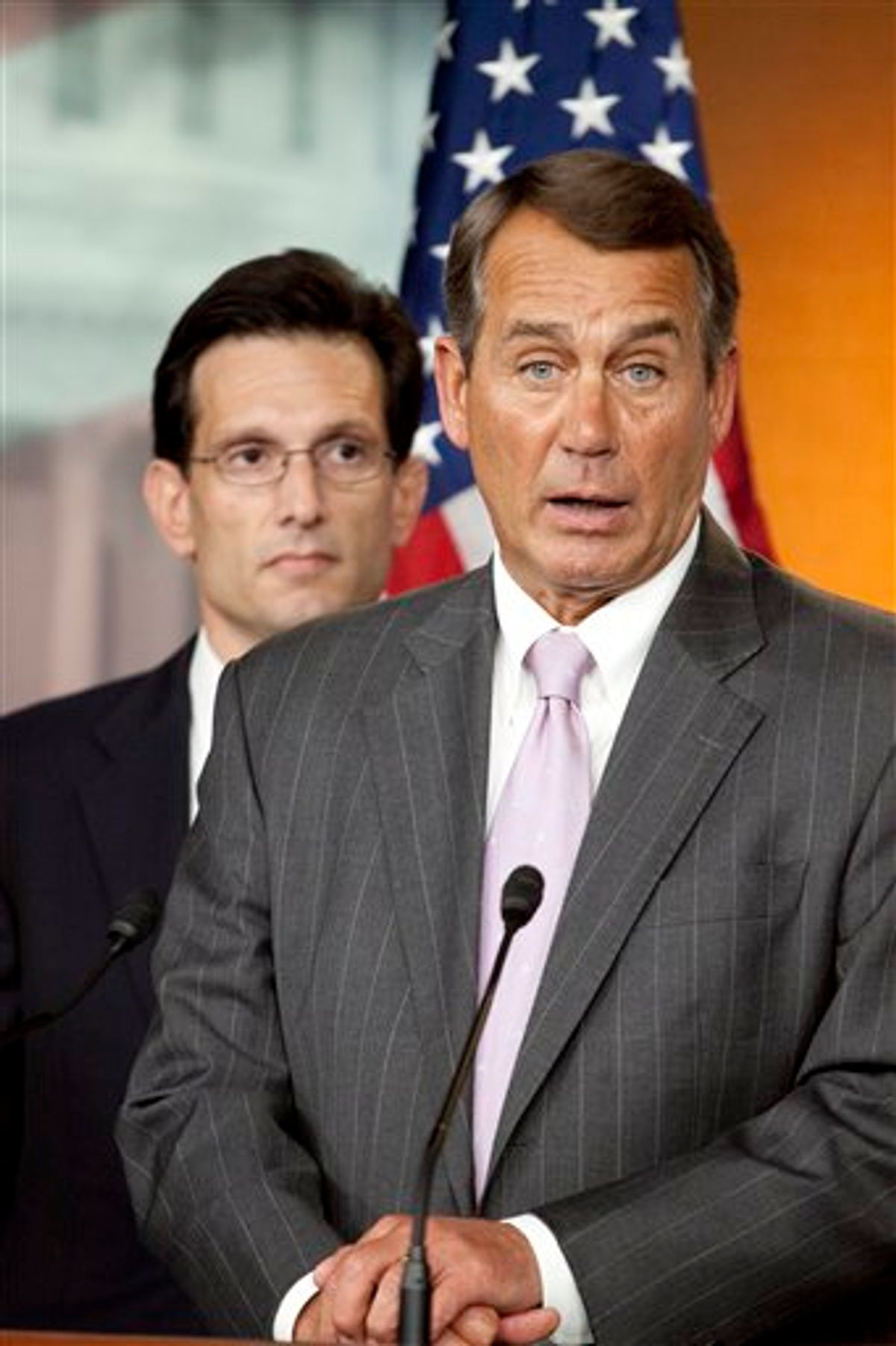 FILE - In this April 5, 2010 file photo, House Minority Leader John Boehner of Ohio, right, accompanied by House Minority Whip Eric Cantor of Va., speaks on Capitol Hill in Washington. Boehner could walk down most U.S. streets anonymously. But the perpetually tanned golf lover, who grew up in a Cincinnati family of 14, could become the next House speaker and the GOP leader of opposition to President Barack Obama.  (AP Photo/Harry Hamburg, File)  (AP)