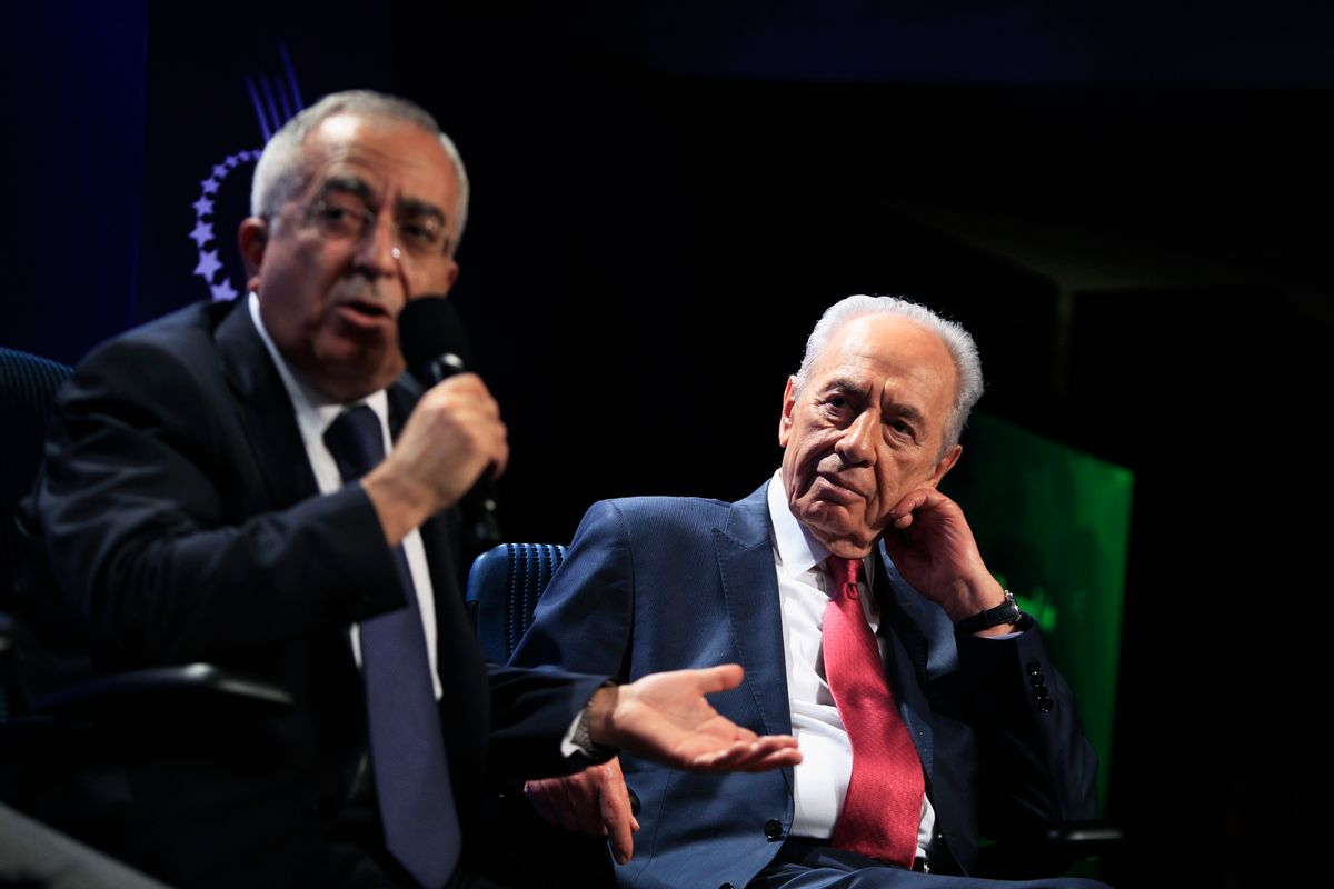 Israeli President Shimon Peres (R) listens to Palestinian Prime Minister Salam Fayyad during a special session addressing peace in the Middle East at the Clinton Global Initiative in New York September 21, 2010.  REUTERS/Lucas Jackson (UNITED STATES - Tags: POLITICS BUSINESS IMAGES OF THE DAY)  (Reuters)