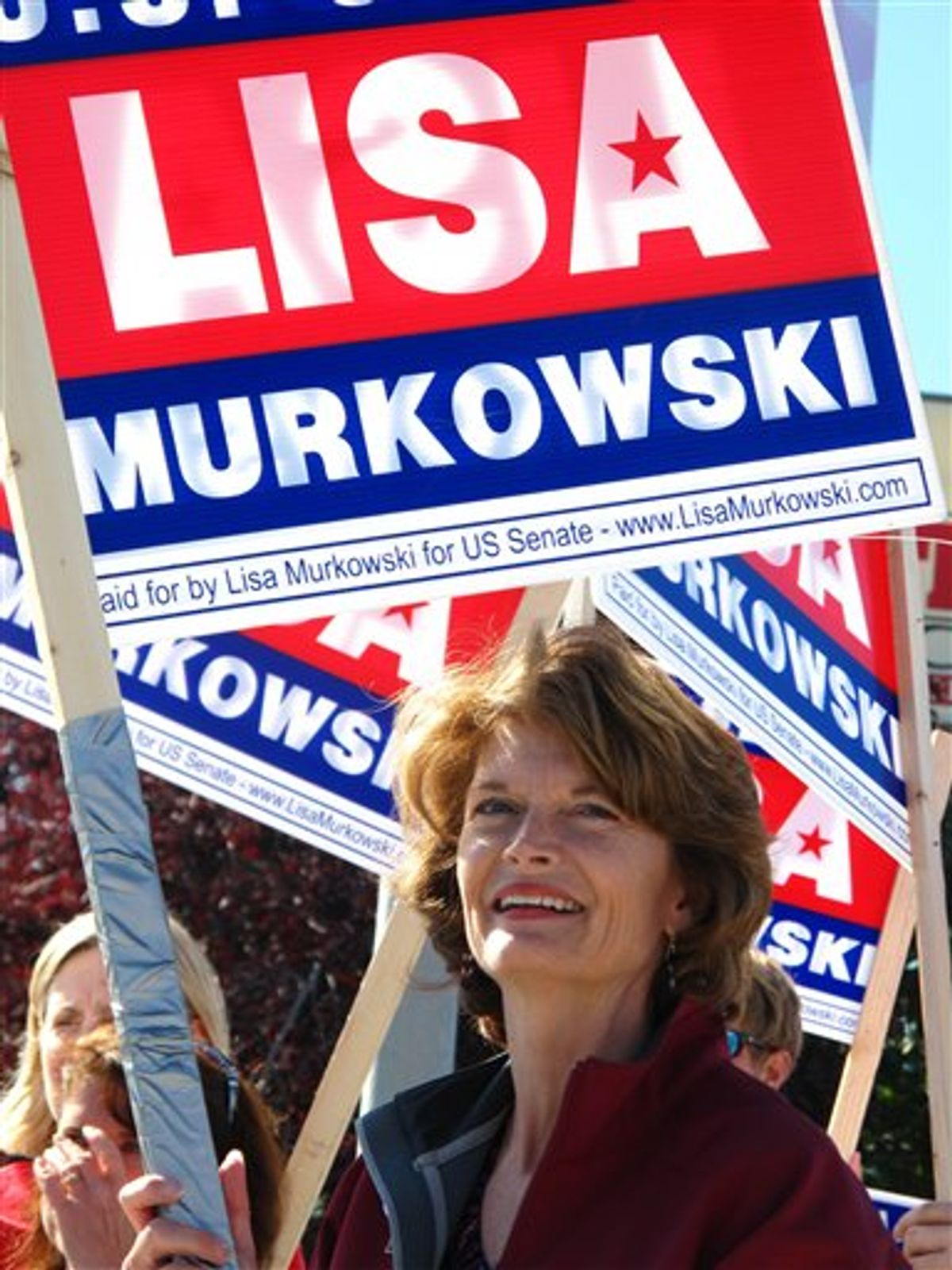 """U.S. Sen. Lisa Murkowski, R-Alaska, right, joins volunteers to wave to motorists on Monday, Aug. 23, 2010, in Anchorage, Alaska.  Candidates are pulling no punches in their last minute push for voters in Tuesday's primary. The greatest proof of this is in the U.S. Senate race where Sarah Palin has re emerged months after first endorsing GOP challenger Joe Miller to urge Alaskans to support him and to oust Murkowski. Murkowski's not shying away, running a new radio spot of her own, called """"Truth,"""" in which she uses audio from a talk show host's tirade against Miller to show Miller as distorting her record. (AP Photo/Mark Thiessen) (AP)"""