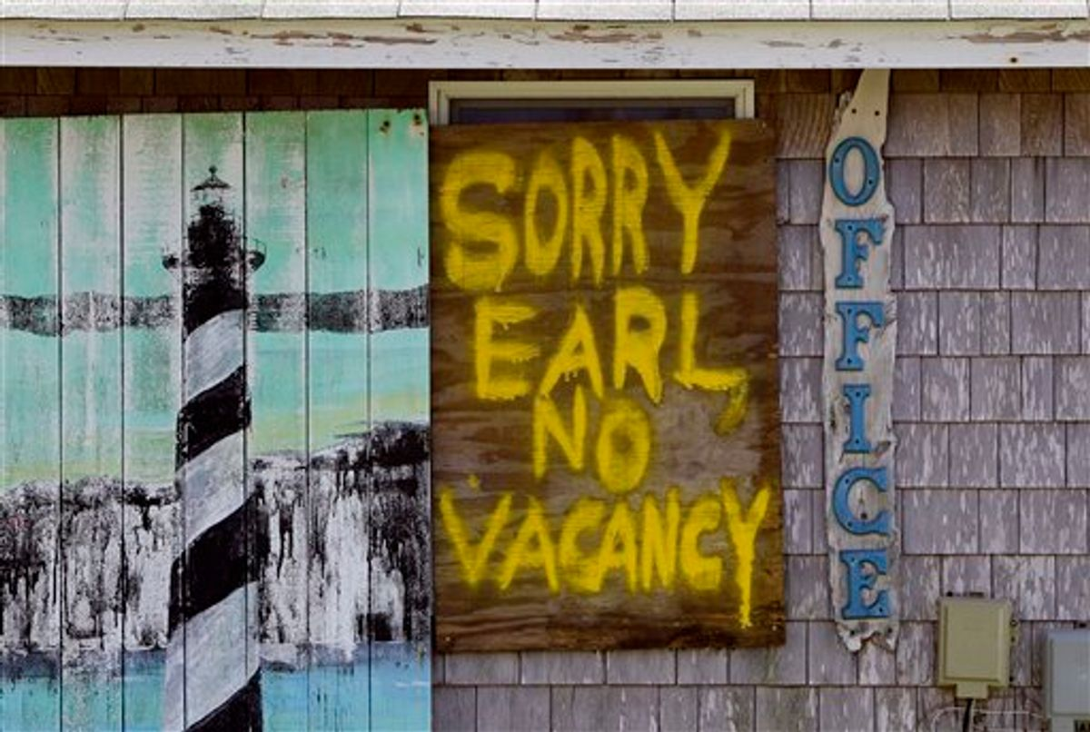 A window is boarded up with a message at the Buxton Beach Motel in Buxton, N.C., Wednesday, Sept. 1, 2010 as Hurricane Earl approaches North Carolina's Outer Banks. (AP Photo/Gerry Broome) (AP)