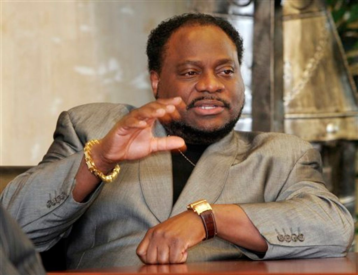 FILE - In this Jan. 18 2007 file photo, Bishop Eddie Long, of the New Birth Missionary Baptist Church, in Lithonia, Ga. gestures during an interview in Lithonia. Two men on Tuesday, Sept. 21, 2010 filed a lawsuit accusing Long of exploiting his role as pastor of an Atlanta-area megachurch to coerce them into sexual relationships when they were members of his congregation. (AP Photo/Gene Blythe, File) (AP)