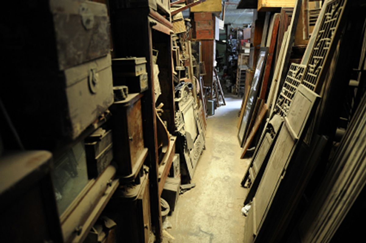 Collection of old dirty, covered by dust furniture. Dark basement ambience.