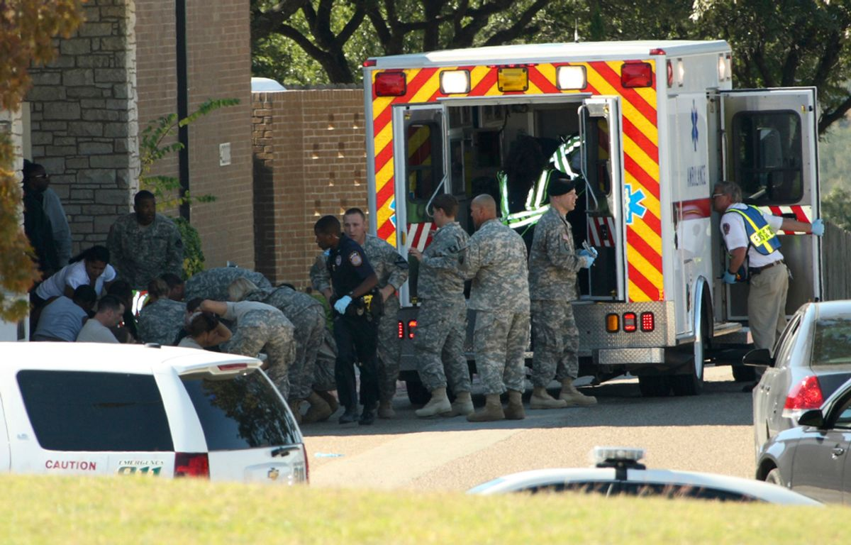 First responders prepare the wounded for transport in waiting ambulances outside Fort Hood's Soldier Readiness Processing Center, after a mass shooting at the military base November 5, 2009. Investigators searched for the motive on Friday behind the mass shooting at the sprawling U.S. Army base in Texas, in which an Army psychiatrist trained to treat war wounded is suspected of killing 13 people. The suspected gunman, Major Nidal Malik Hasan, a Muslim born in the United States of immigrant parents, was shot four times by police, a base spokesman said. He was unconscious but in stable condition. Photo taken November 5, 2009.    REUTERS/Jeramie Sivley/U.S. Army photo/Handout    (UNITED STATES MILITARY CRIME LAW CONFLICT HEALTH) FOR EDITORIAL USE ONLY. NOT FOR SALE FOR MARKETING OR ADVERTISING CAMPAIGNS     (© Ho New / Reuters)