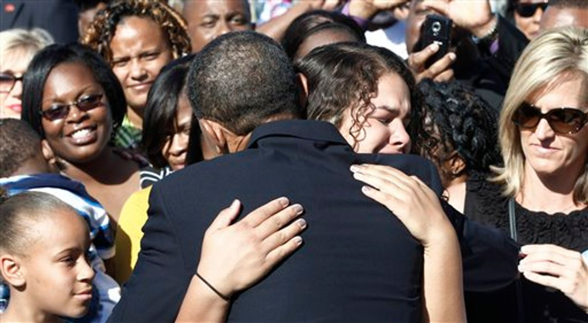 President Barack Obama hugs an unidentified woman as he greets family members of victims after speaking at the Pentagon Memorial, marking the ninth anniversary of the September 11 attacks, Saturday, Sept. 11, 2010. (AP Photo/Charles Dharapak) (AP)