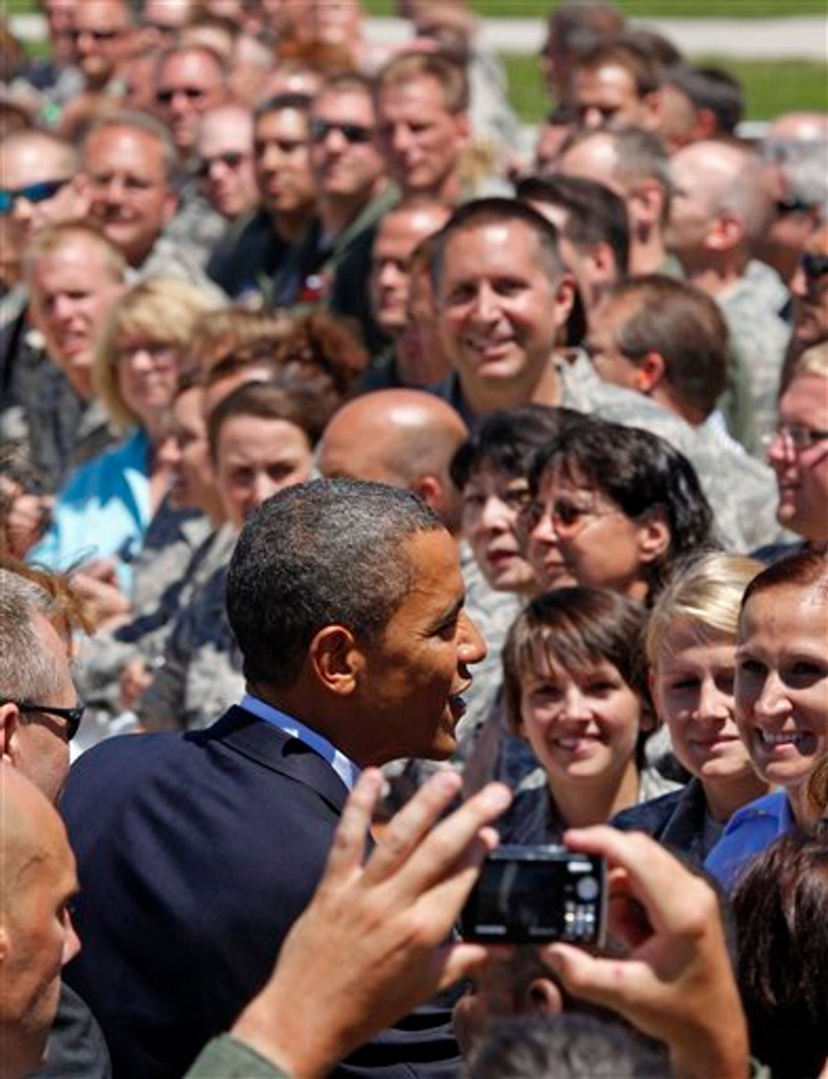 FILE - In this June 30, 2010 file photo, President Barack Obama greets members of the Wisconsin National Guards 128th Air Refueling Wing upon his arrival at Mitchell International airport in Milwaukee, Wis. When President Barack Obama makes his third Wisconsin visit in a little over two months Monday, he will get a chance to shore up his base at a Labor Day rally in a state where his approval ratings are dipping and fellow Democrats face tough re-election bids.  (AP Photo/Jeffrey Phelps, File) (AP)