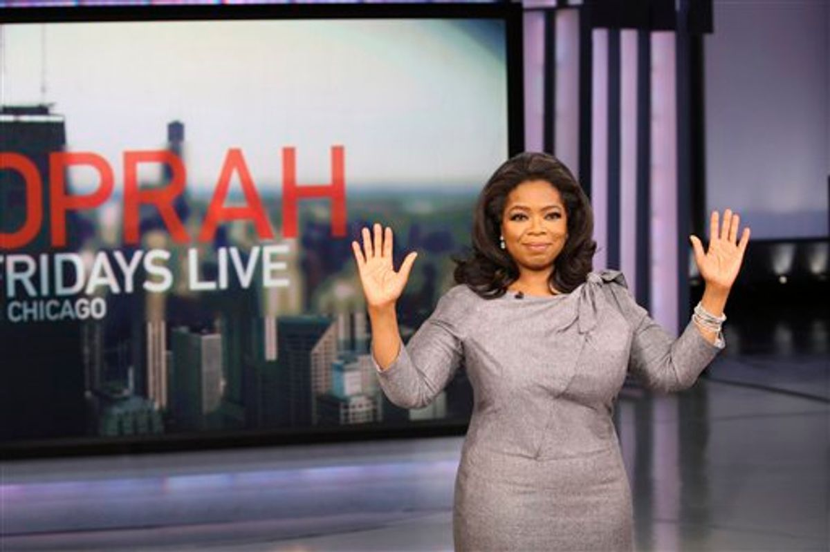 """FILE - In this Nov. 20, 2009 file photo originally provided by Harpo Productions Inc., talk-show host Oprah Winfrey announces during a live broadcast of """"The Oprah Winfrey Show"""" in Chicago that her daytime television show, the foundation of a multibillion-dollar media empire with legions of fans, will end its run in 2011 after 25 seasons on the air. On Monday, Sept. 13, 2010, the 25th and final season of """"The Oprah Winfrey Show"""" starts airing. (AP Photo/Harpo Productions, Inc., George Burns, File)   MANDATORY  CREDIT,  NO SALES   (AP)"""