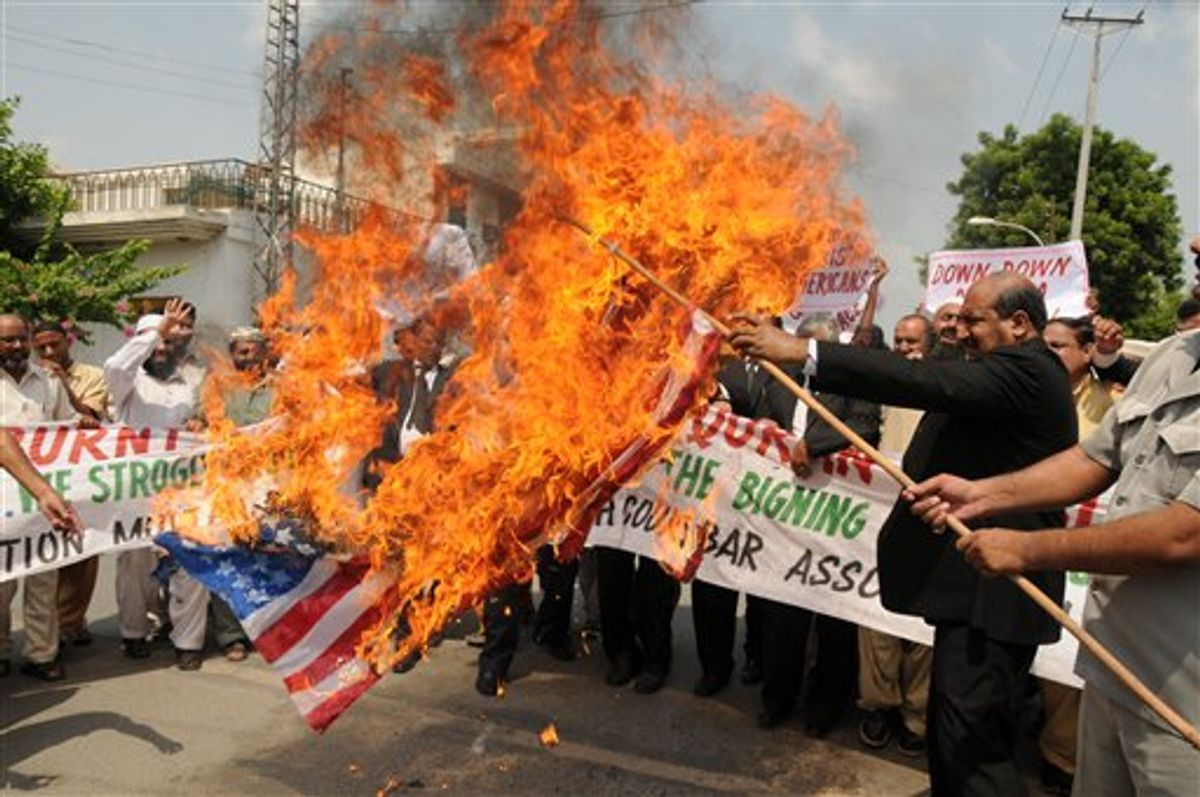 Pakistani lawyers burn a U.S. flag while rallying in reaction to a small American church's plan to burn copies of the Quran in Multan, Pakistan on Thursday, Sept. 9, 2010. (AP Photo/Khalid Tanveer)  (AP)