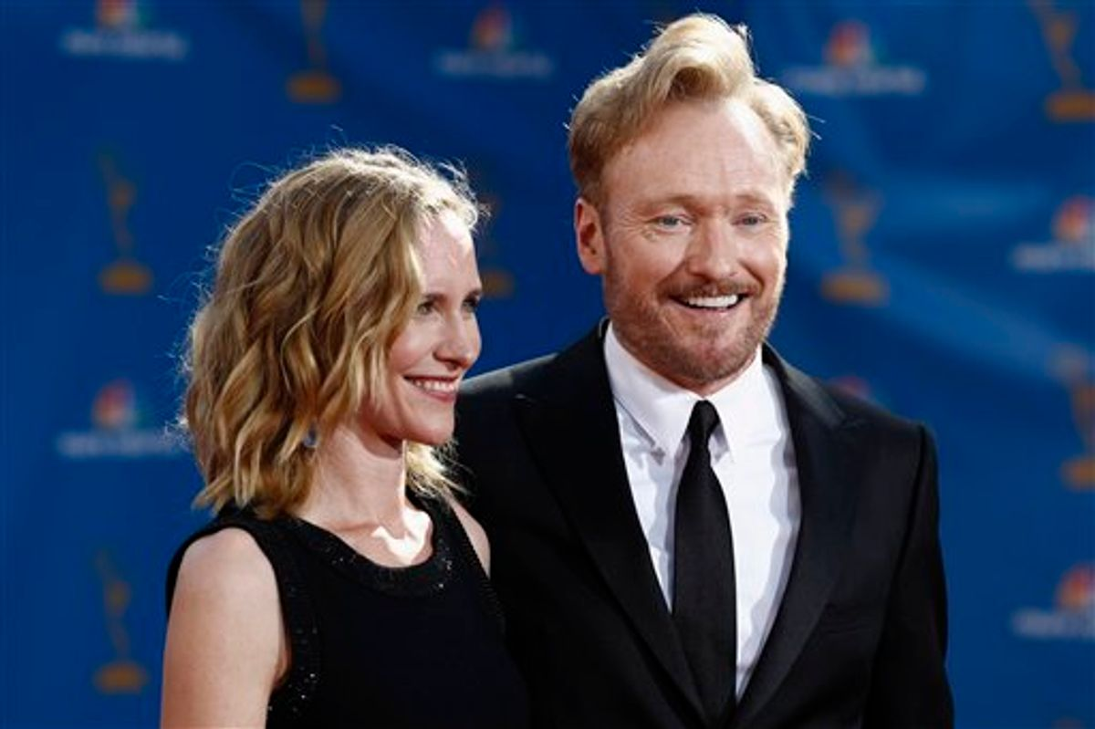 Conan O'Brien and wife Liza Powel arrive for the 62nd Primetime Emmy Awards Sunday, Aug. 29, 2010, in Los Angeles. (AP Photo/Matt Sayles) (AP)