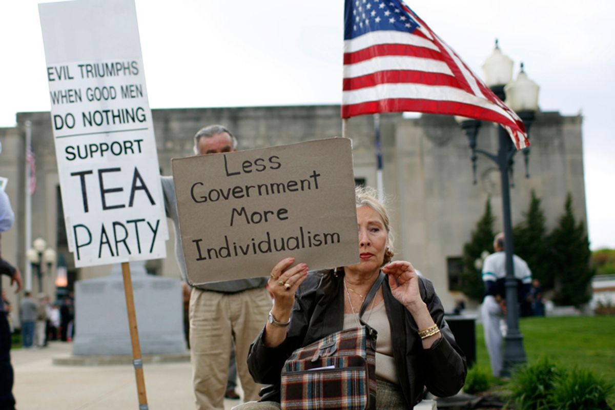 A woman holds a sign at a tax day rally by Tea Party activists in the New York City suburb of New City, New York, April 15, 2010. April 15 is the deadline for filing tax returns in the U.S.  REUTERS/Mike Segar  (UNITED STATES - Tags: BUSINESS POLITICS)      (© Mike Segar / Reuters)
