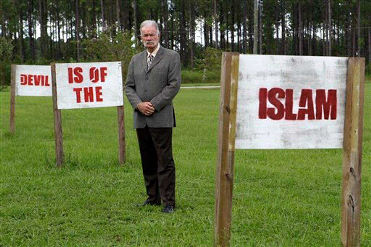 In this photo taken Monday, Aug. 30, 2010,  Rev. Terry Jones poses for a photo at the Dove World Outreach Center in Gainesville, Fla. Jones vowed to go ahead with plans to burn copies of the Quran to protest the Sept. 11 terrorist attacks despite warnings from the White House and the top U.S. general in Afghanistan that doing so would endanger American troops overseas. (AP Photo/John Raoux) (AP)