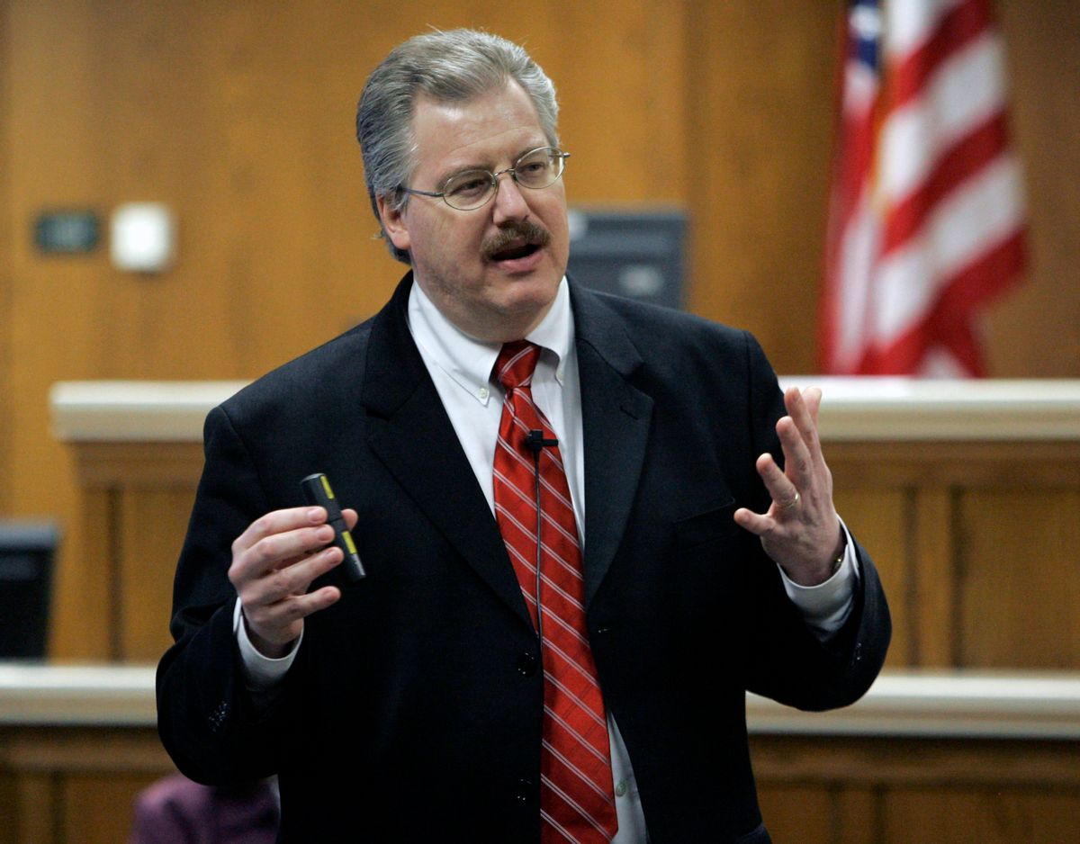 ** FILE **This March 2007 file photo shows Calumet County District Attorney Kenneth Kratz giving his closing argument in the Steven Avery trial in the courtroom in Chilton, Wis. Police say Kratz sent repeated text messages trying to spark an affair with a domestic abuse victim while he was prosecuting her ex-boyfriend. (AP Photo/Morry Gash)     (Morry Gash)