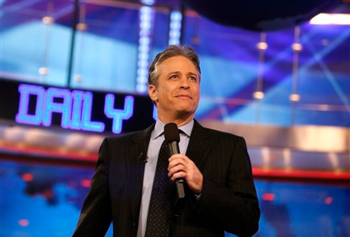 """FILE - In this March 12, 2009 file photo, Jon Stewart is shown during a taping of Comedy Central's """"The Daily Show with Jon Stewart"""" in New York.  (AP Photo/Jason DeCrow, file) (AP)"""