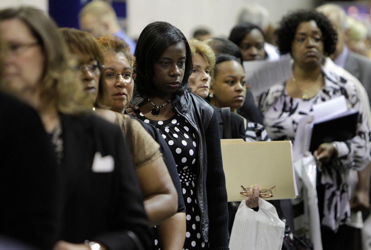 Job seekers attend a job fair in Southfield, Mich.  (AP/Paul Sancya)