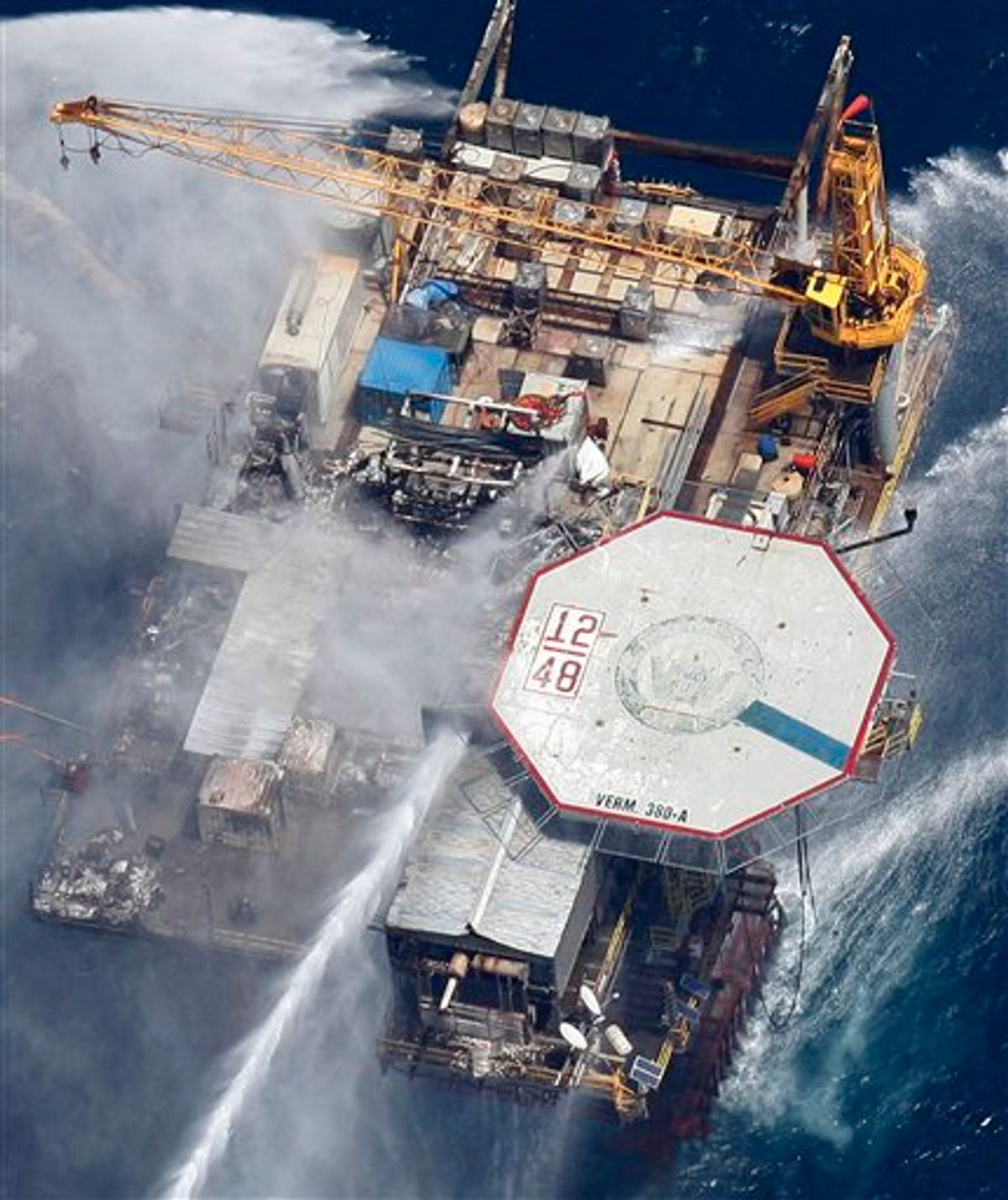 Boats are seen spraying water on an oil and gas platform that exploded in the Gulf of Mexico, of the coast of Louisiana., Thursday, Sept. 2, 2010. All 13 crew members were rescued.  (AP Photo/Gerald Herbert) (AP)