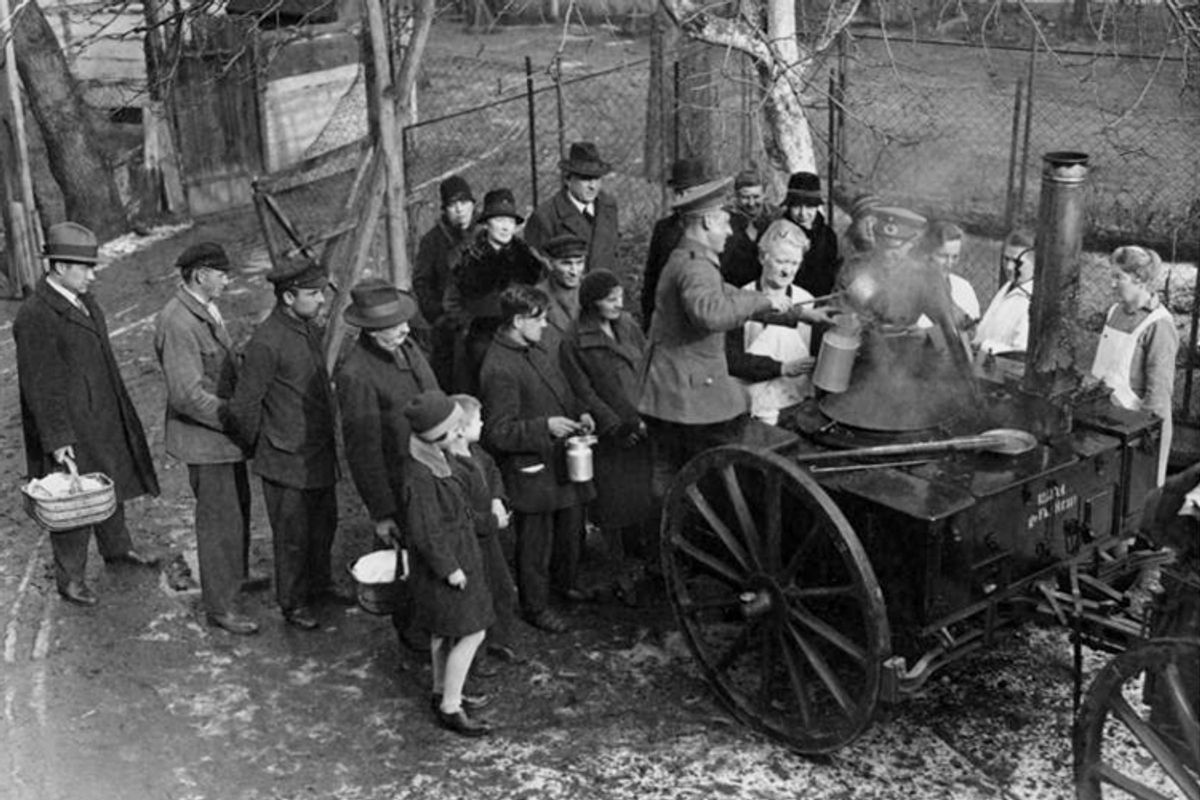 The German Army feeds the poor in Berlin in 1930.