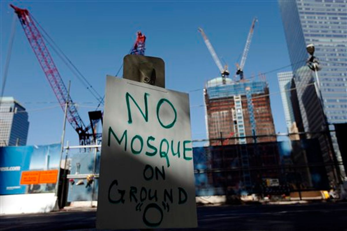 A sign opposing a proposed Islamic community center near ground zero is seen in New York, Saturday, Sept. 11, 2010. (AP Photo/Matt Rourke) (AP)