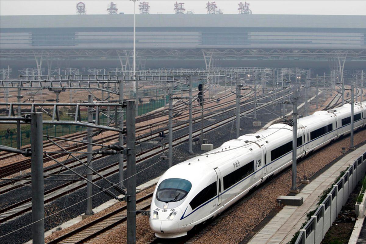 A high-speed train travels on the newly built Shanghai-Nanjing railway in Shanghai.