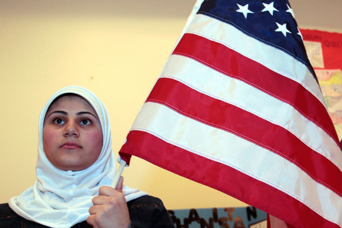 A young Muslim American woman holds the U.S. flag at the Islamic Center of America in Dearborn, Michigan on March 26.