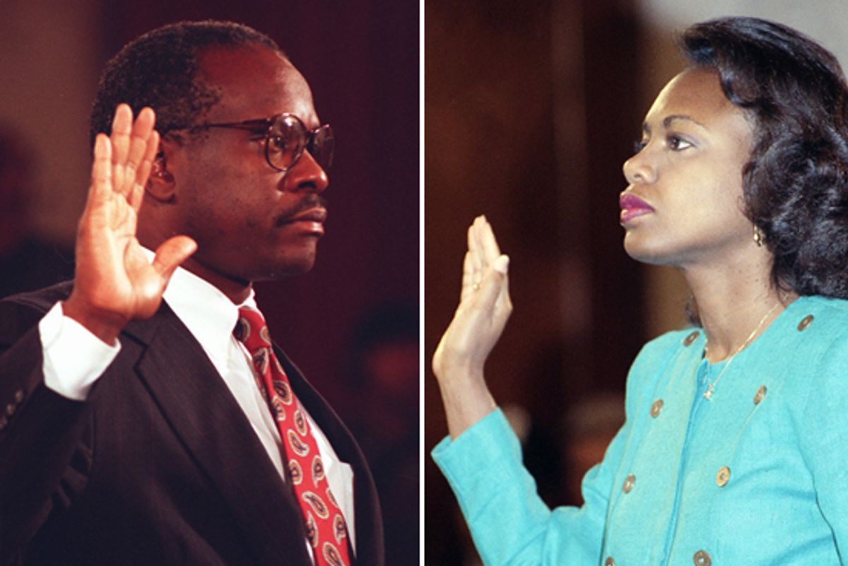 Judge Clarence Thomas, left, and Anita Hill are sworn in before testifying to the Senate judiciary Committee on Capitol Hill, Oct. 1991