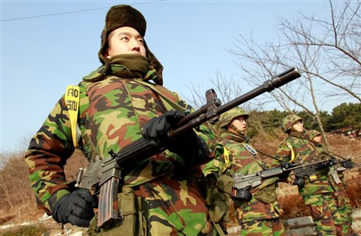 South Korean marines stand guard near the their military base on the Yeonpyeong Island, South Korea, Saturday, Nov. 27, 2010. Tensions have soared between the Koreas since the North's strike Tuesday destroyed large parts of Yeonpyeong in a major escalation of their sporadic skirmishes along the disputed sea border. (AP Photo/Lee Jin-man) (AP)