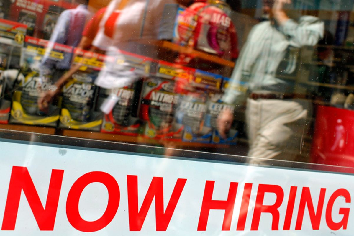 """A """"Now Hiring"""" sign in the window of a GNC store in Boston."""